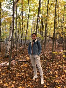 Picture of me in the forest, fall leaves on the ground