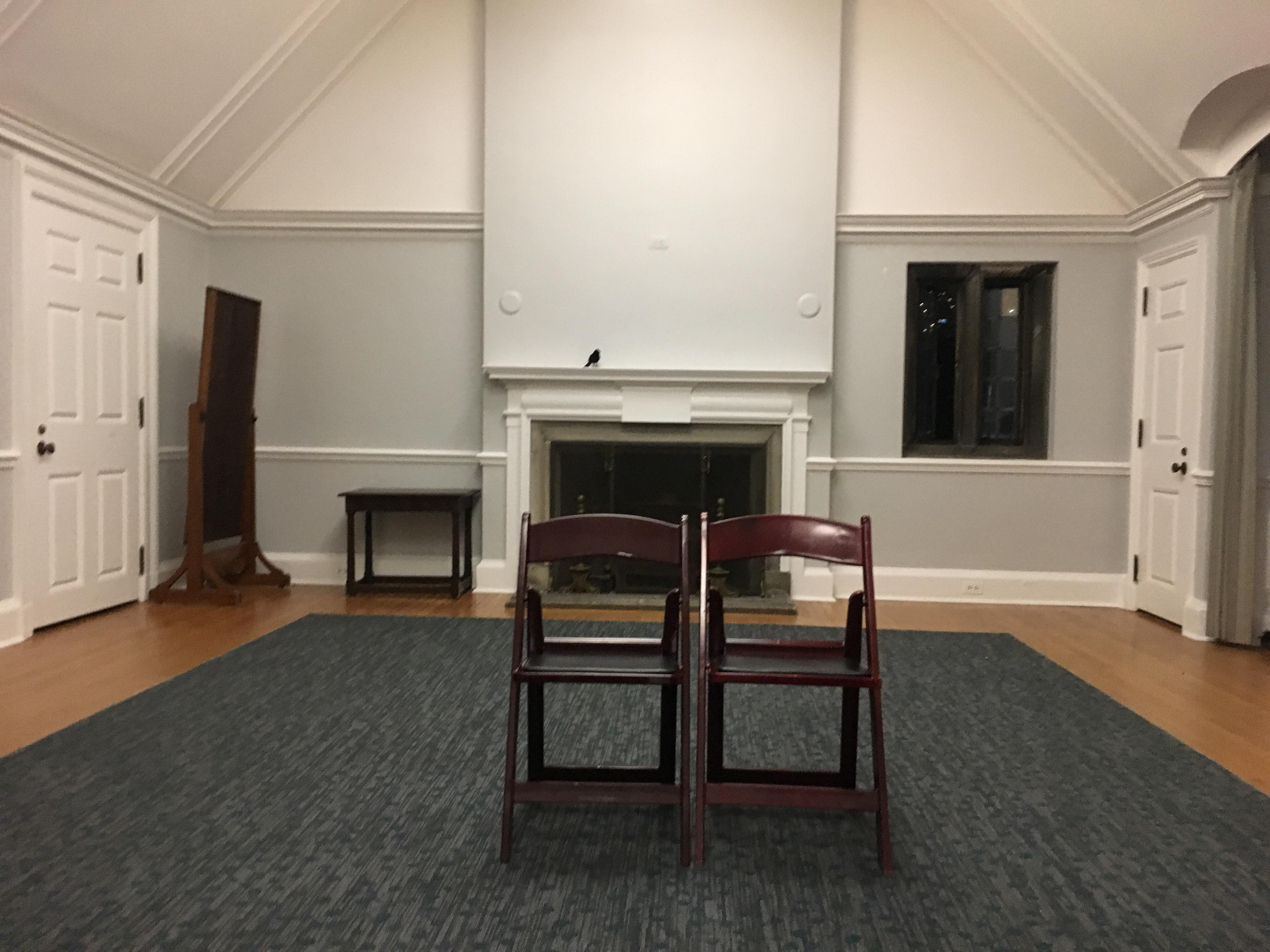 Picture of a room with two brown chairs sitting side by side