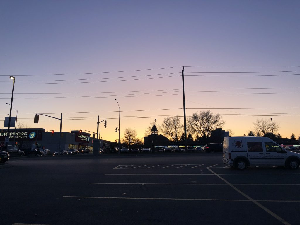 Sunset in parking lot.