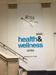 "A picture of a staircase with a sign that reads ""Health and Wellness centre"""