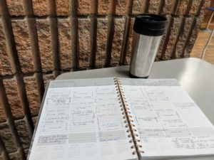 Open agenda with thermos on a table