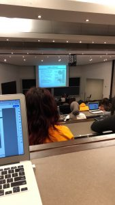 Picture of my laptop and a lecture hall