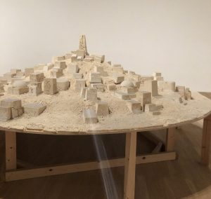 A scaled down city model, made out of cooked couscous.