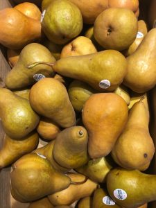 A trough full of brown pears.