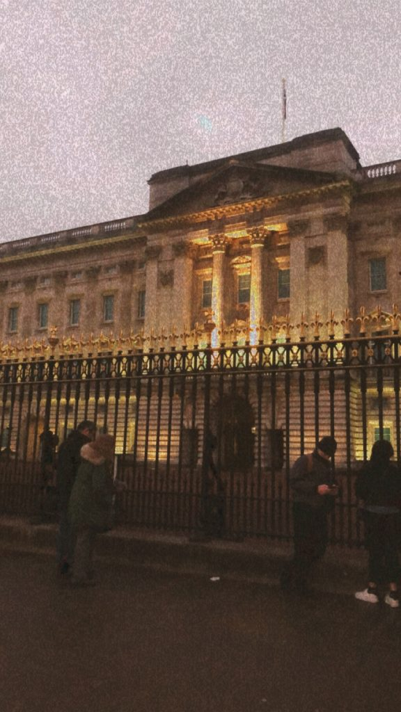 The front view of Buckingham Palace. The picture is edited to make the image look grainy