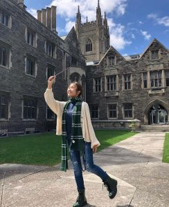 Picture of me outside of Hart House, in Harry Potter-inspired outfit