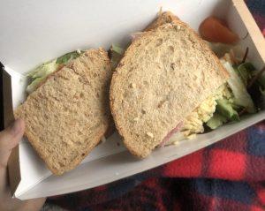 A sandwich in a paper box.