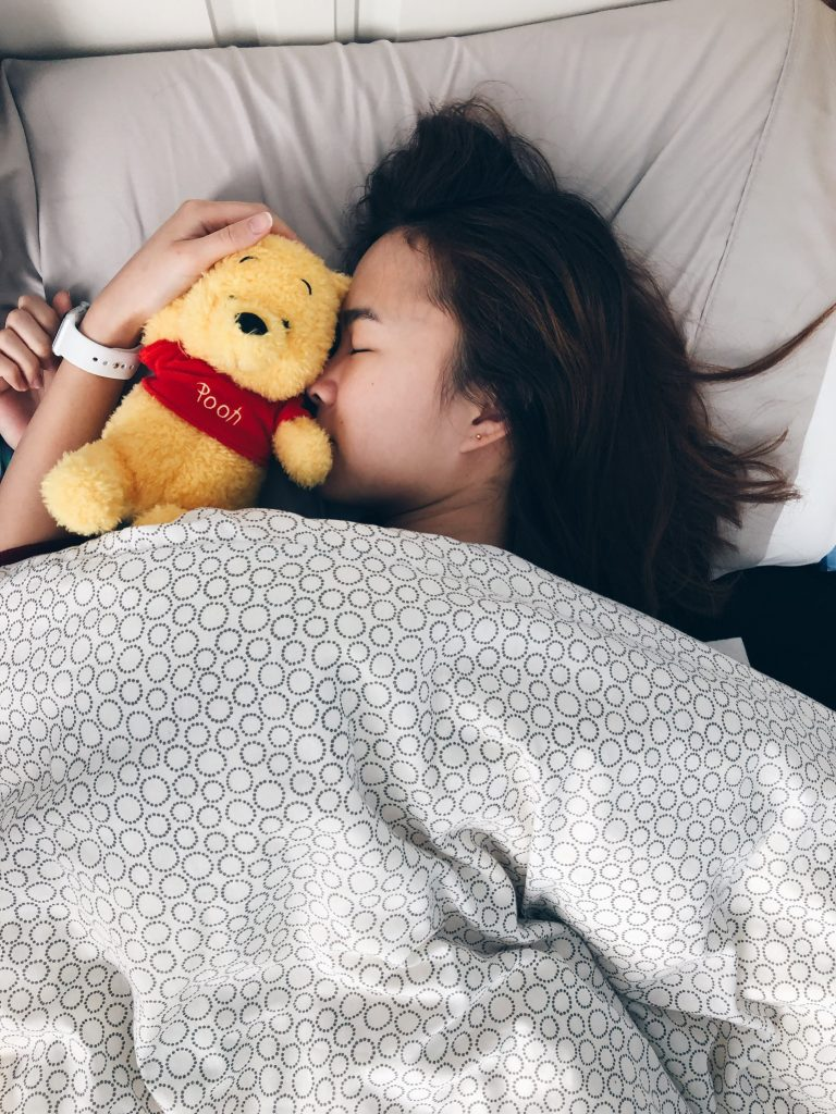 Picture of my hugging a toy in my bed