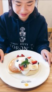 Picture of me and a plate of Japanese pancakes