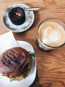 Picture of a burger, brownie, and a cup of coffee