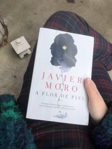 "Francesca holding a book called ""A Flor de Piel""."