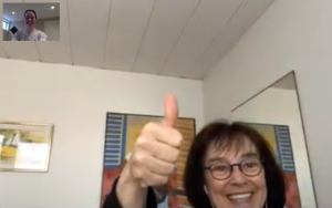 A screenshot of a FaceTime call. In the main screen, a teacher gives a thumbs-up. In the corner screen, the author is smiling.