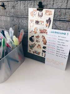 Picture of my to-do list, stickers, and pens