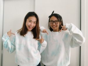 picture of me and my sister wearing matching tie dye sweatshirts