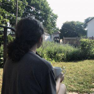 Olive sitting outside.