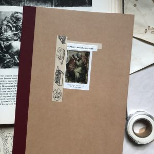 Front cover of notebook that says 'Hellenistic Art' with a sticker on the front.