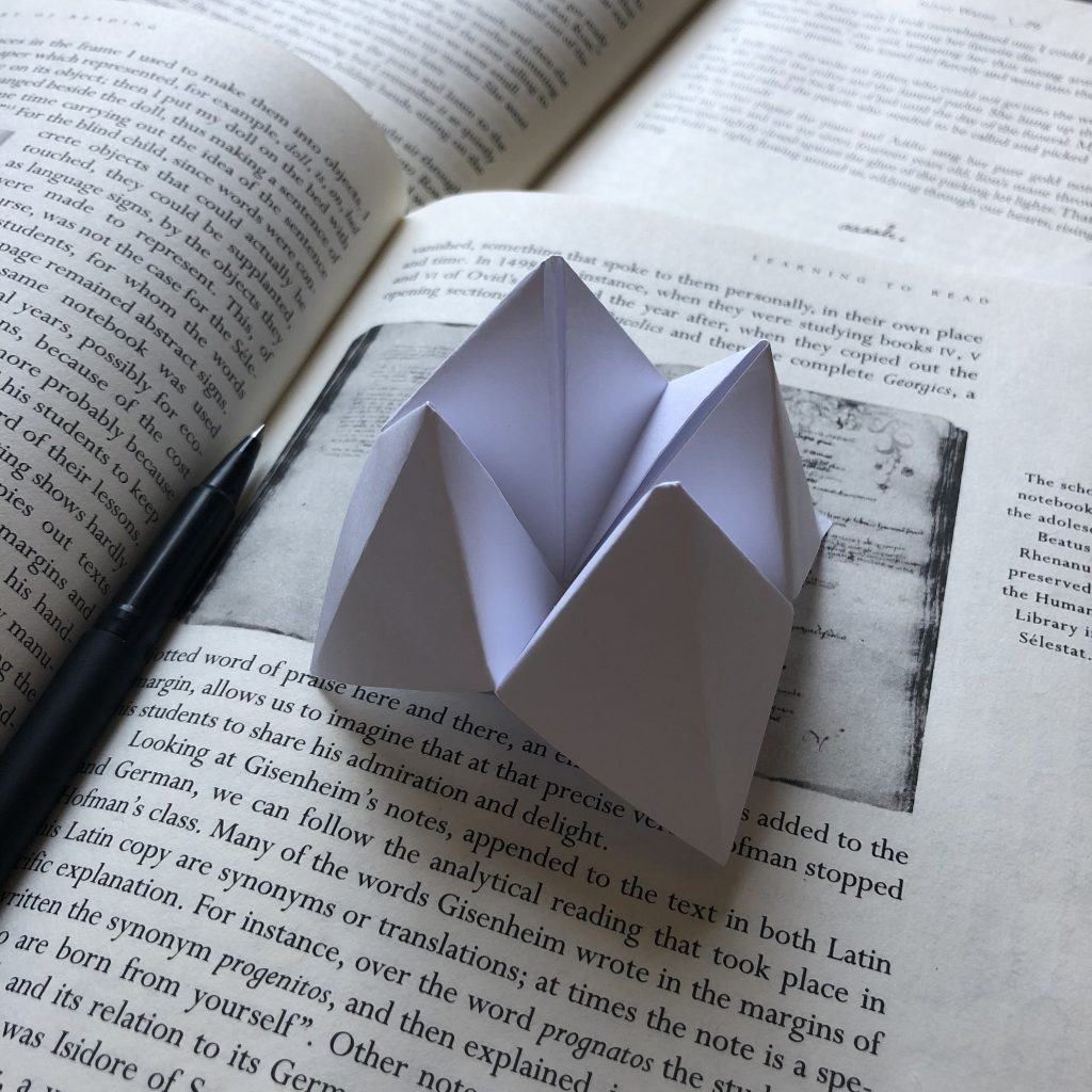 Cootie catcher on books.