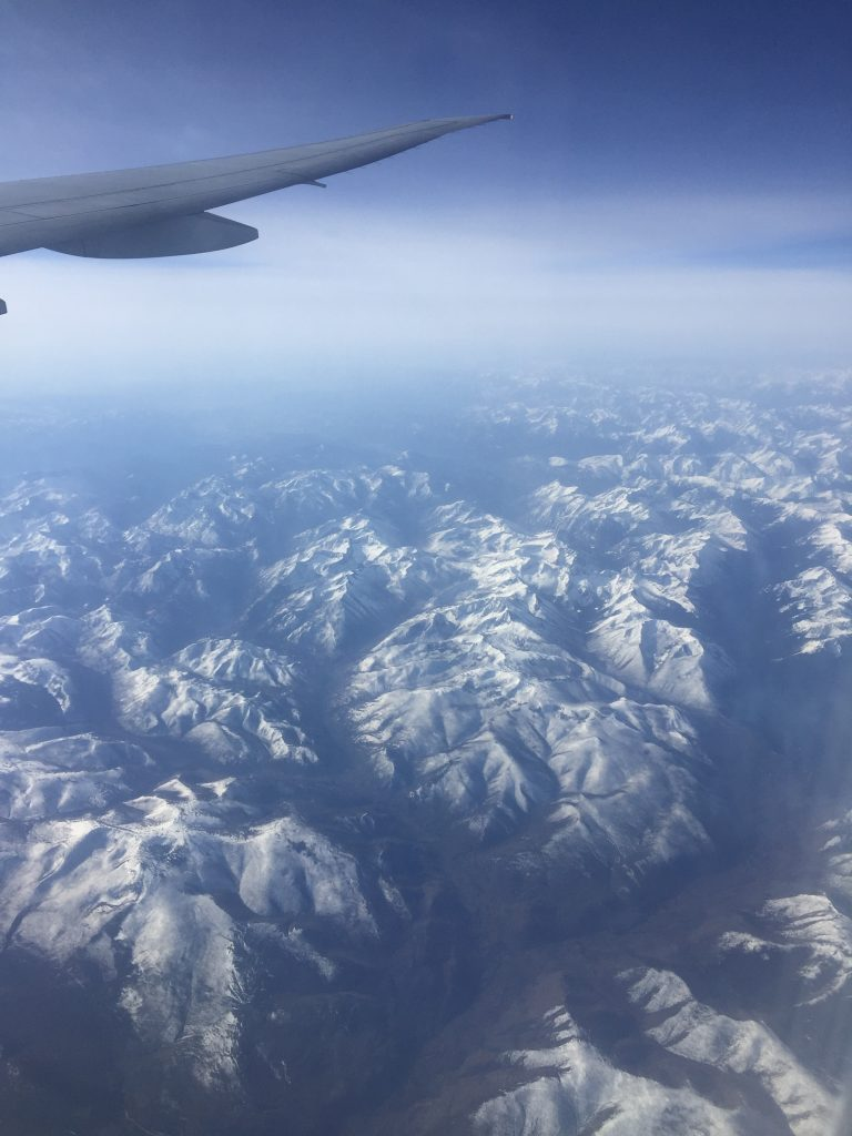 A picture of mountains from a plane