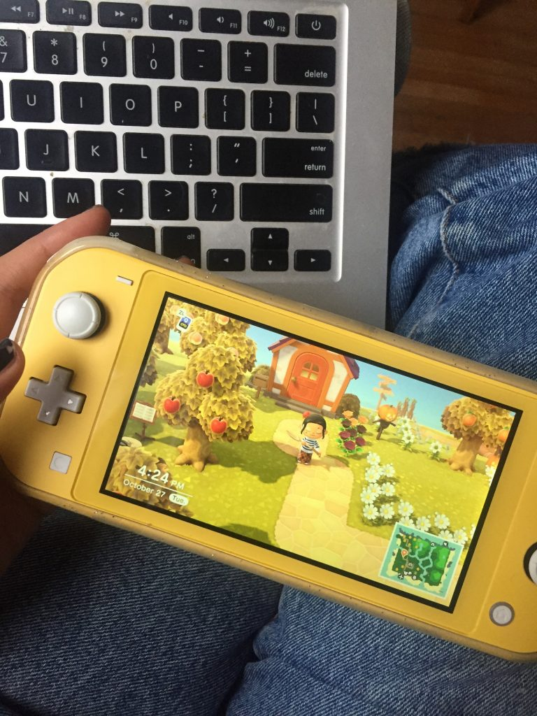 A picture of a person playing Animal Crossing a