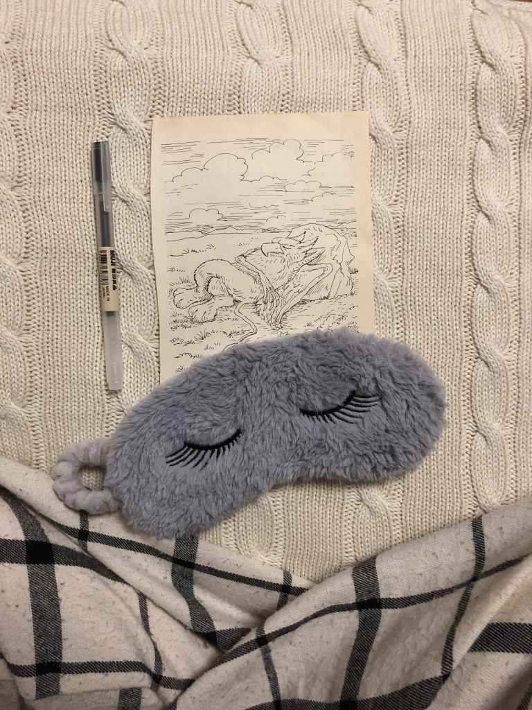 Sleep mask and image of sleeping griffin from Alice in Wonderland.