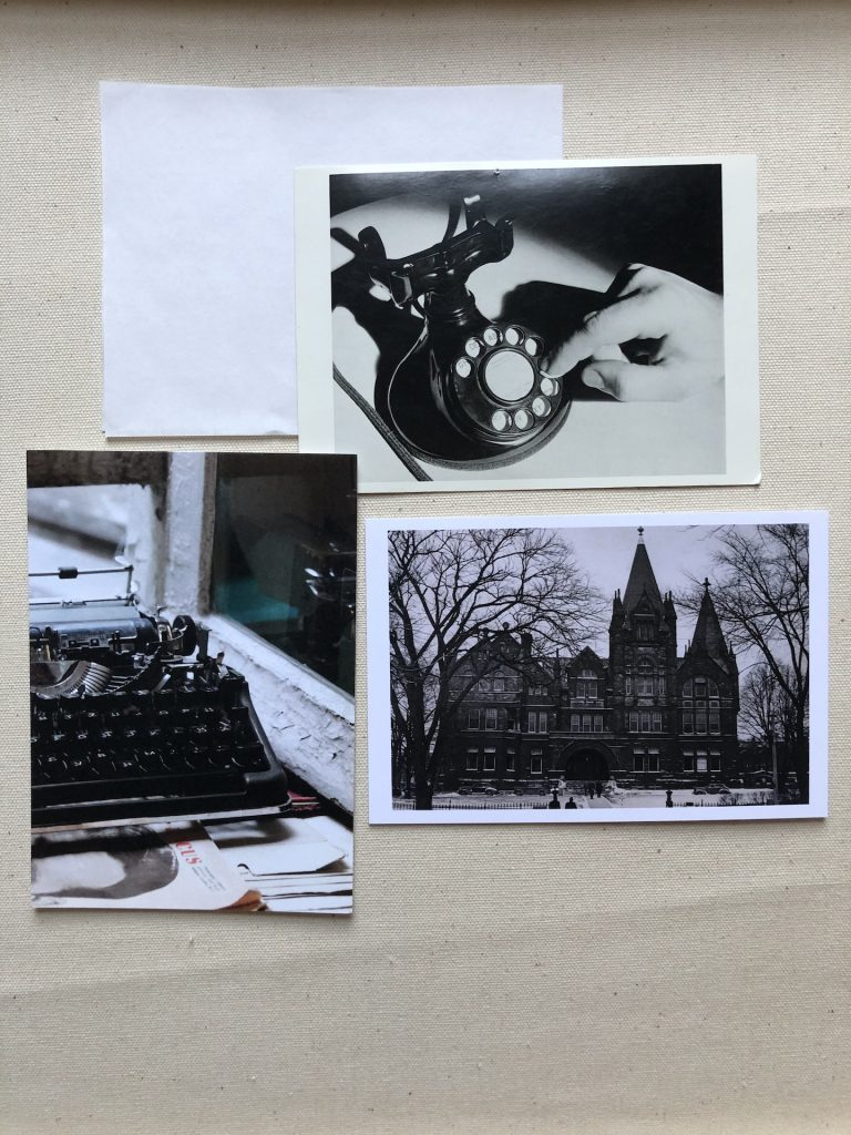 three black and white postcards