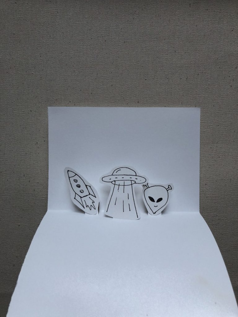 popup card with alien, spaceship, and rocket