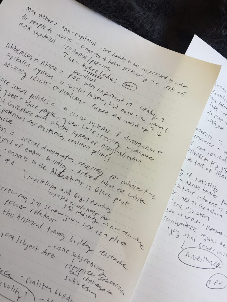A picture of a piece of paper with scribbled text across it