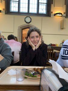 Olive, sitting in burwash dining hall.