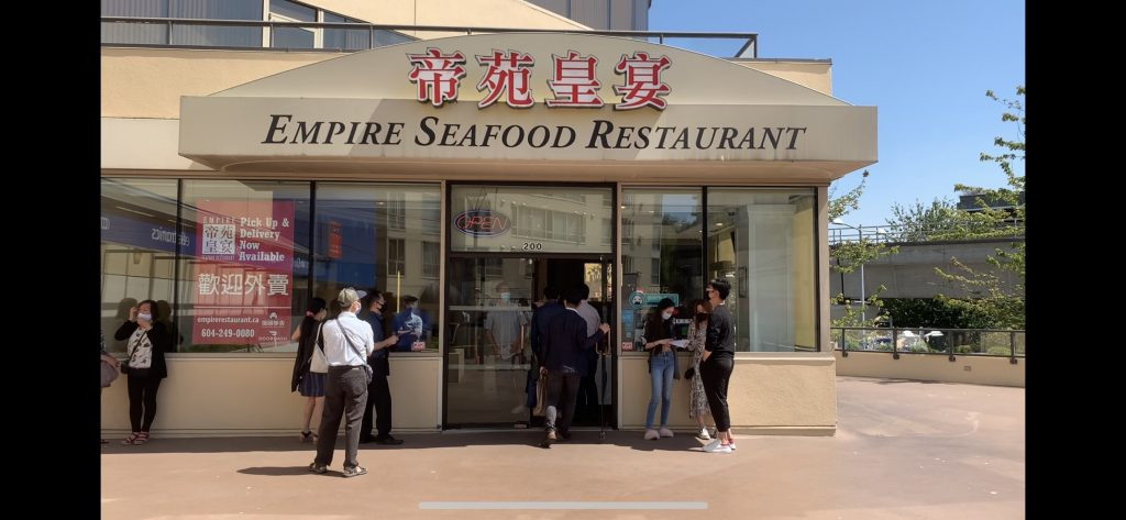 A still of the front of a dimsum crowded around by patrons restaurant in Richmond, B.C.