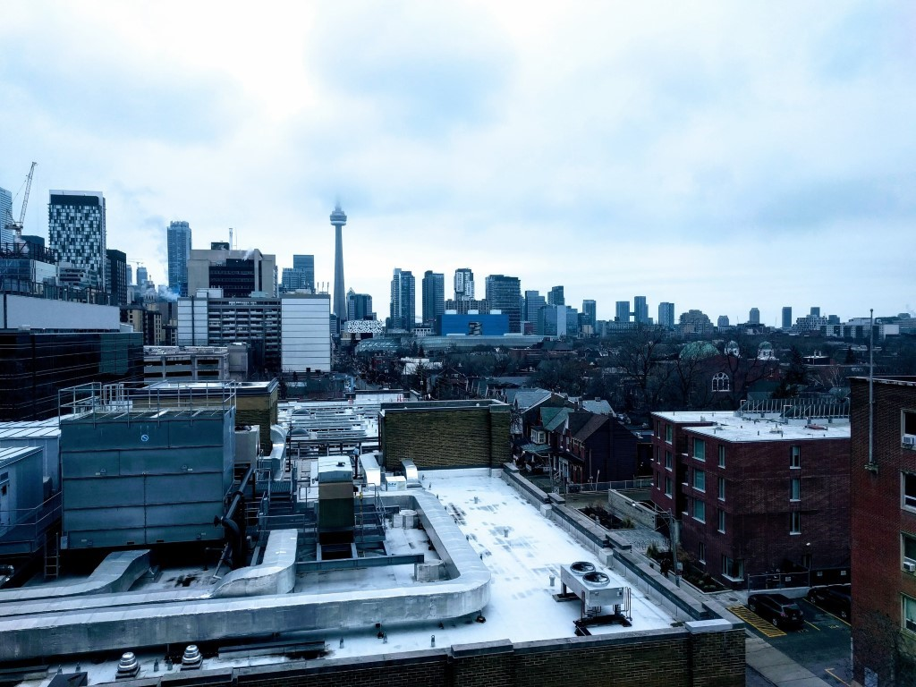 A snowy city skyline of Toronto in winter time, looking over the University of Toronto St. George campus.