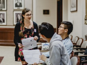 Three students having an animated discussion