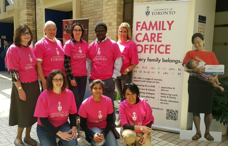 Peer mentors wearing pink shirts, standing together outside of the Family Care Office.