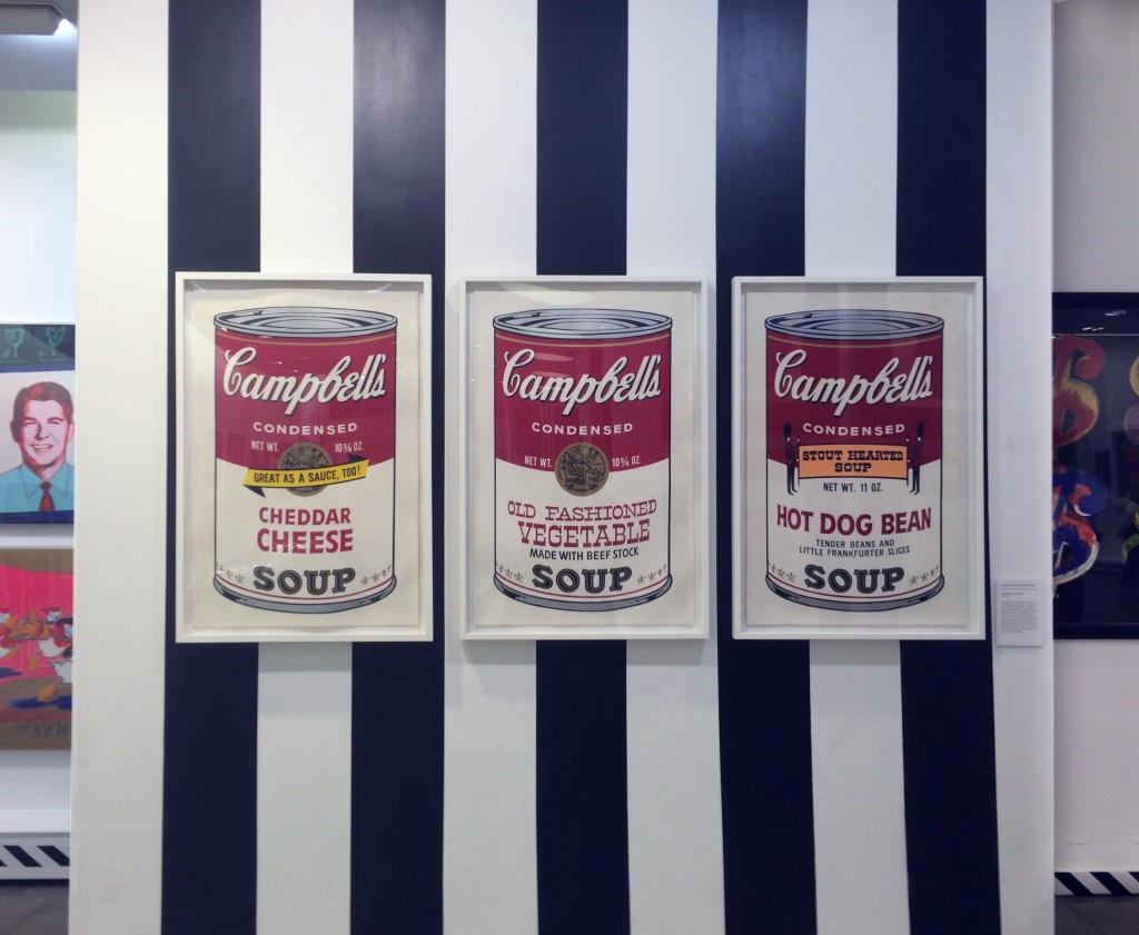 three of Warhol's iconic Campbell's Soup Cans