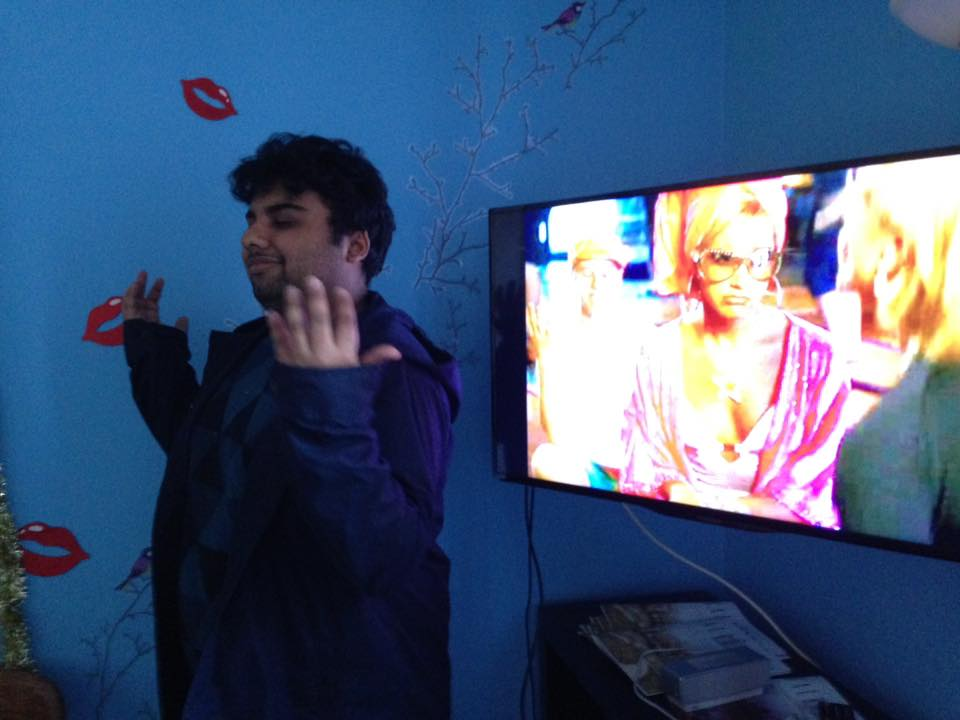 Picture of Avneet in front of TV showing High School Musical