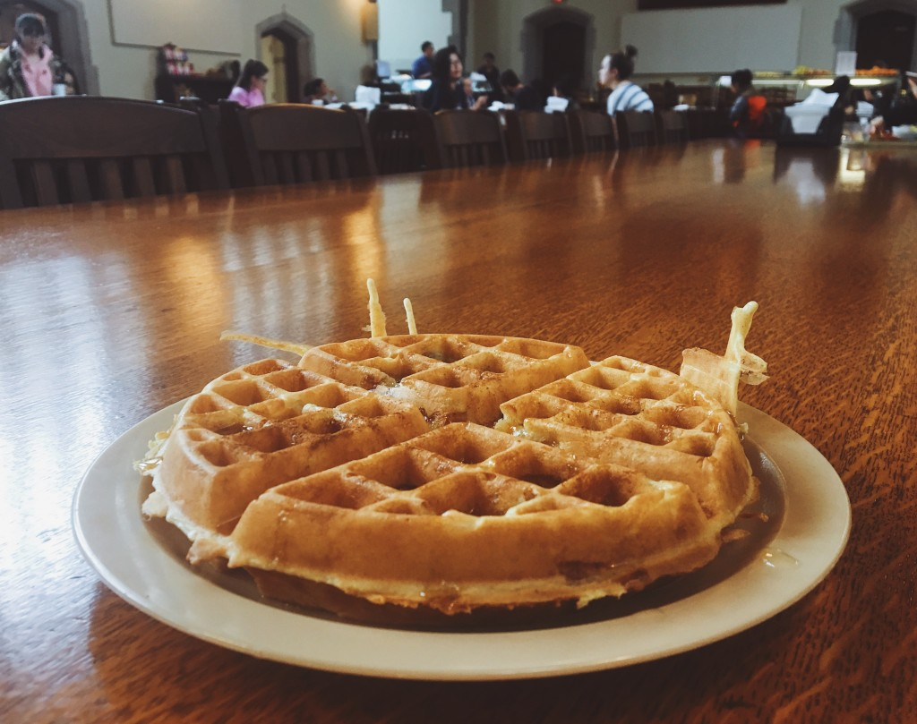 A photo of a waffle on top of a dining hall table.