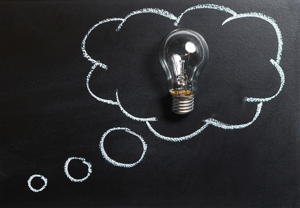 A lightbulb with chalk drawn around it