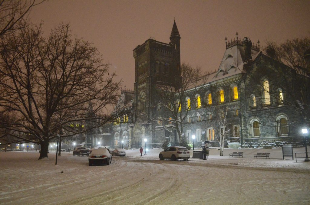 night time shot of University College in winter