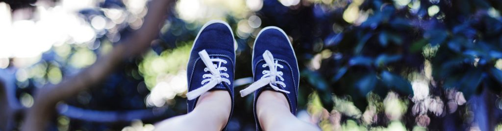 A photo of Emi's feet in her Keds.