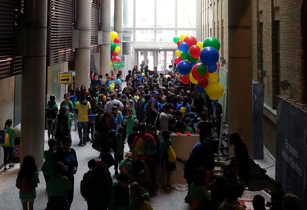 Bahen Centre main hallway decked in balloons and filled with students