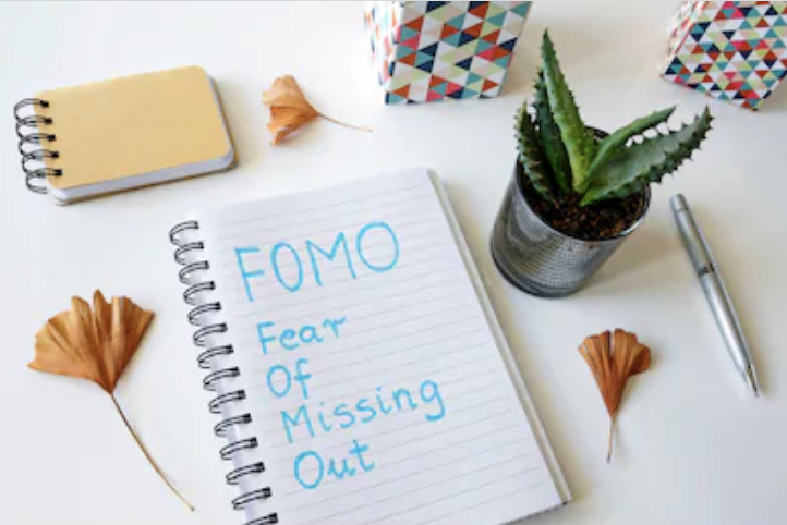 FOMO written on a notebook