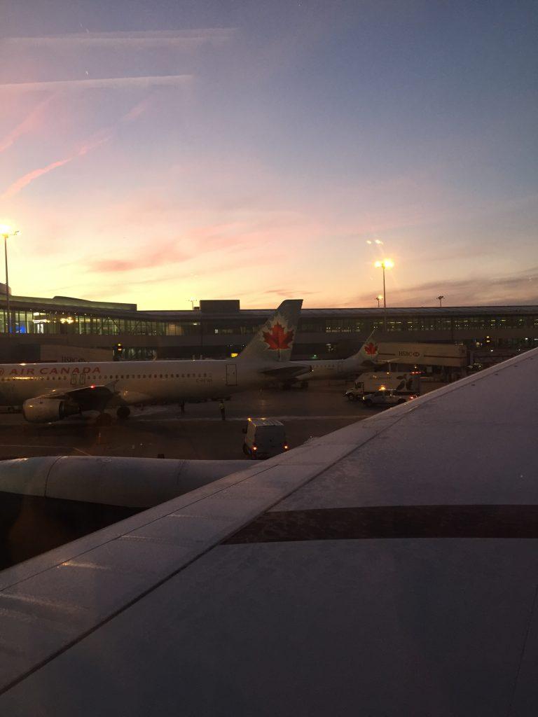 An airport runway at dawn.