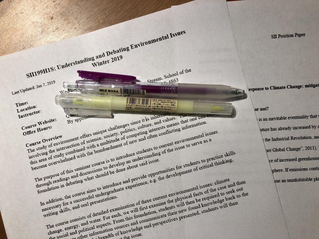 Picture of pens, SII 199 syllabus, and SII debate paper