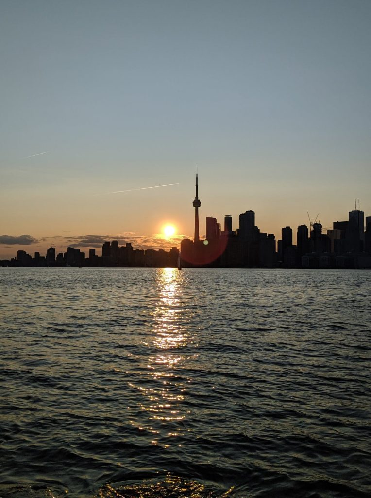 Lake, sunset, and Toronto skyline in the background