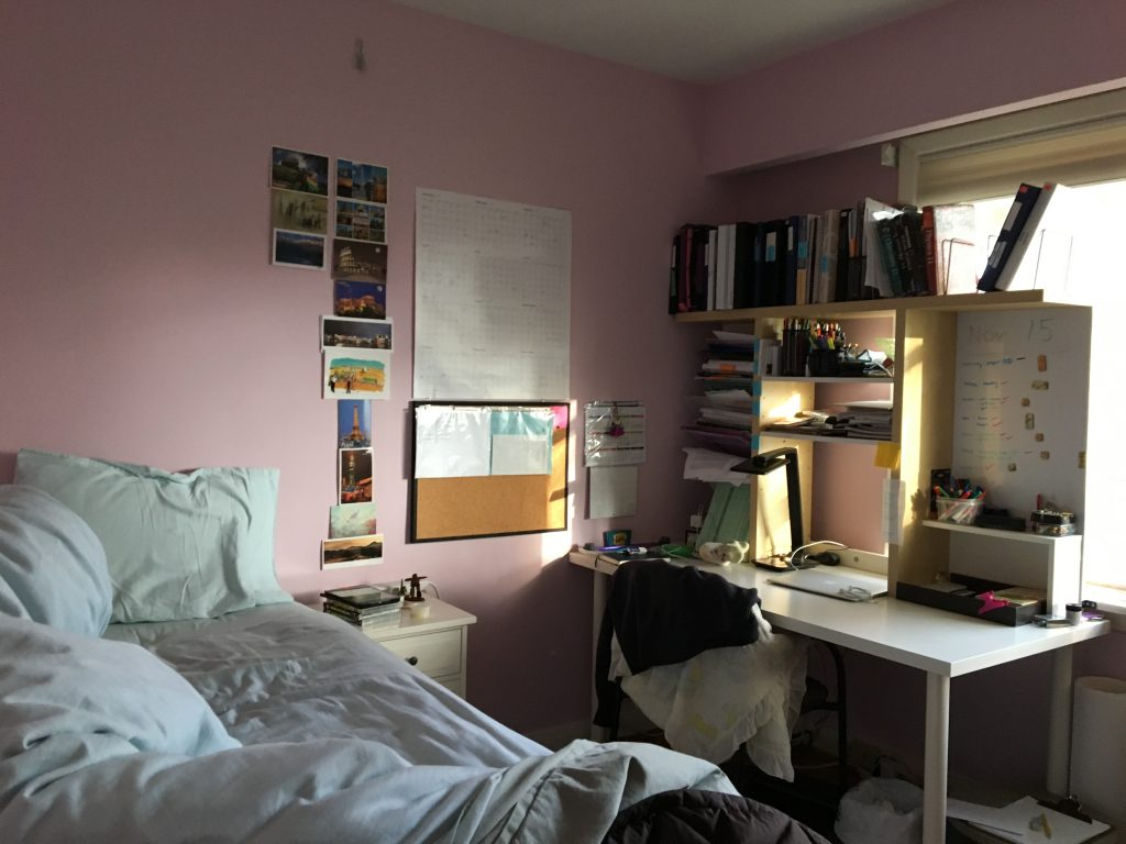 Photo of bedroom with desk filled with homework