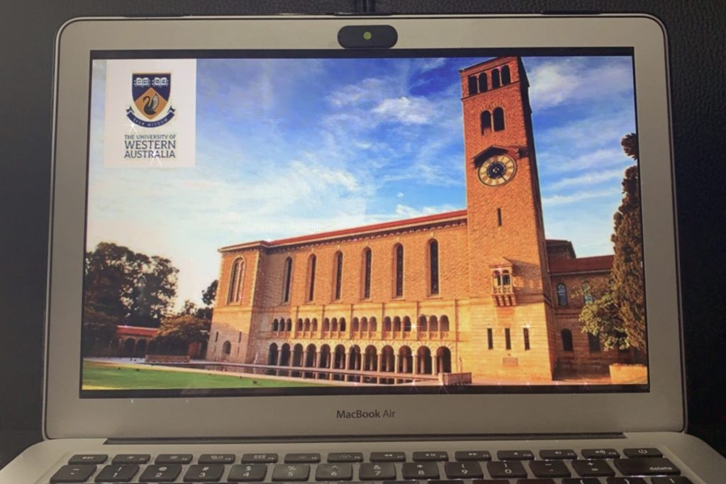 MacBook Air with a picture of the UWA building on the screen