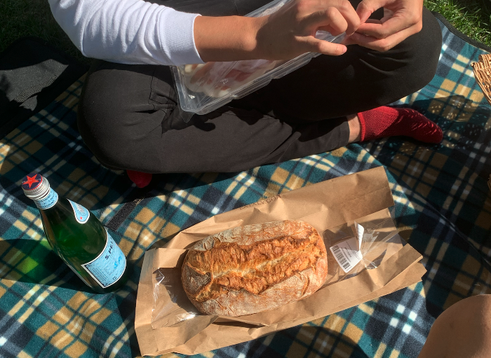 overview of a picnic set up with sparkling water and bread
